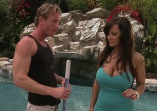 Lisa Ann with big tits getting her pussy licked and shoved in an outdoors shoot