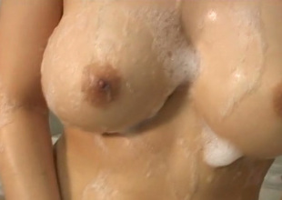 Pigtailed Asian babe with big boobs knows how to make a bathtime hawt