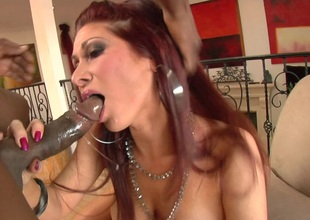 A black chap rams his big wang down Tiffany Minx's mouth