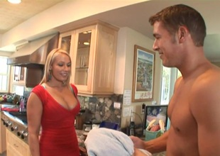 Ambitious blonde with large wobblers getting banged doggystyle in the kitchen