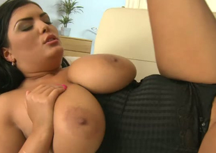 Busty brunette Jasmine Dark likes to lick nuts and play with her boobies