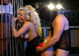 Several furious dudes fuck sex-hungry wench in the cage