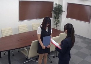 Cutest Japanese office worker gives a titjob and rides the dick