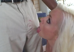 Blonde babe receives facial cumshot after throat fucking black cock