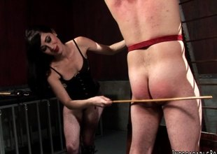 Breathtaking dominatrix with a fabulous body torturing a stranger