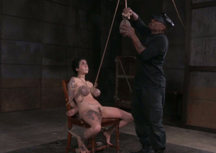 Raven haired busty nympho receives her boobies tied up indeed hard
