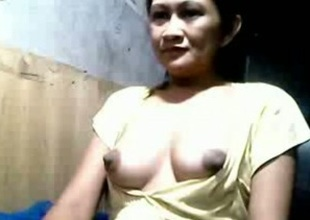 Amazing big mounds with chocolate nipples from mature Filipina