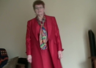White granny in red coat masturbates on home video