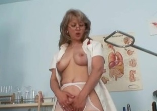 Filthy old mama in nurse uniform wild masturbation