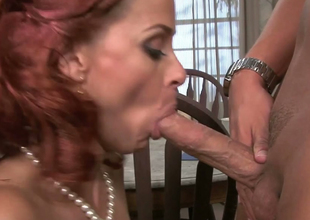 Redhead MILF Payton Leigh gives head to handsome Rocco Reed