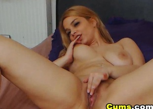 Horny Golden-haired Chick Fingering her Wet Pussy