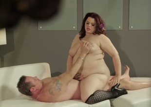 Kelly Shibari is a fat girl with amazing girls. She has a biggest ass and some huge tits. She is getting fucked from all sides and her large tits are worshiped.