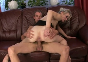 Blonde Angeline is too hot to stop engulfing her mans rock solid cock