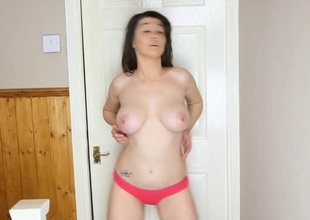 Sexy British beauty in her bathroom stripping sensually