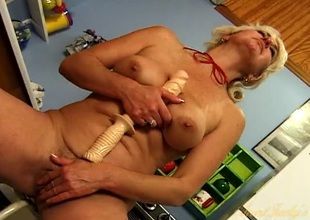 Lascivious naked housewife fucking her pussy with a sex toy