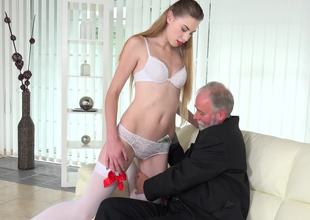 Old businessman fucks a charming blonde escort on the couch