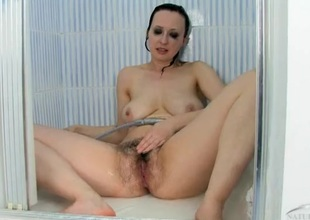 Milf washes off her hairy cunt in the shower
