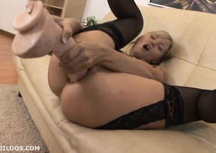 Blonde milf punishes her asshole with a brutal sex tool